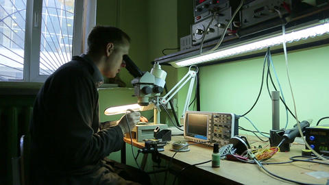 Scientist in the lab looking into a microscope Footage