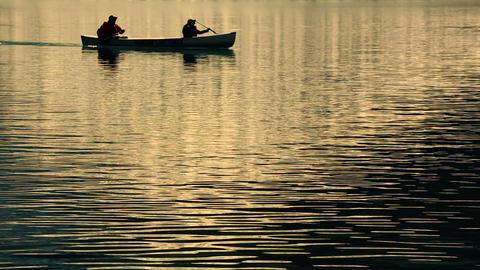 Canoe and mountain lake reflection Footage