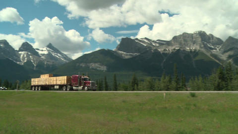 Lumber transport truck in the Rocky Mountains Footage