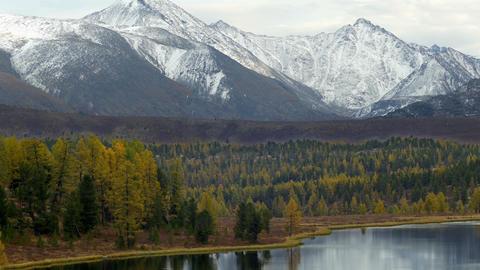 4K UHD Snowy Mountains Above Mountain Lake in Autu Footage