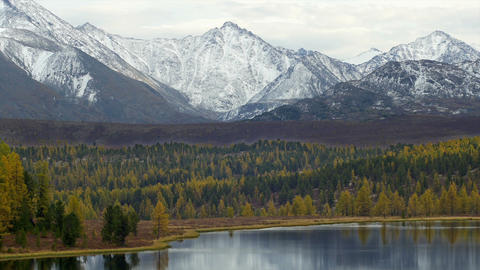 Stock Footage Snowy Peaks Above Mountain Lake in A Footage