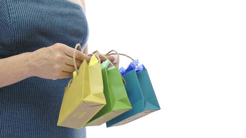 Woman And Three Small Colored Gift Bags stock footage