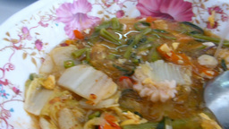 a bowl of Tom Yum soup added with Woon Sen (glass noodle). Thai food Footage