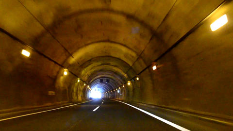 Car Driving On Mountain Highway With Tunnels. POV Footage