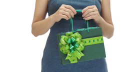 Woman Holding Green Gift Bag stock footage