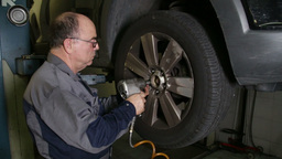 Car Repair Mechanic Changing Wheel stock footage
