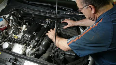 Car Repair Mechanic Assembles Automobile Air Filte Live Action
