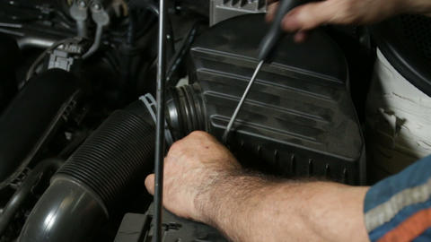 Car Repair Mechanic Screwing Automobile Air Filter Live Action
