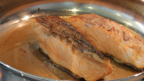 Salmon frying in pan Live Action