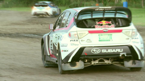 Travis Pastrana Rally Car Leaves Pits stock footage