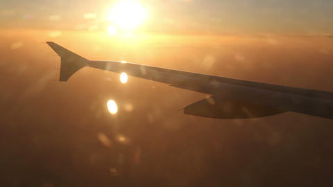 Airplane Turning Towards Sunset stock footage