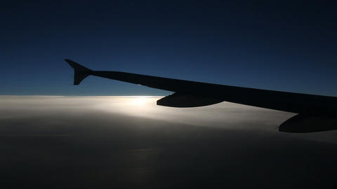 Airplane wing in dramatic lighting Live Action