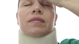 Woman In Neck Brace Tilt Up Close Footage