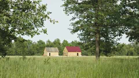 New wooden rural houses are built in a field Footage