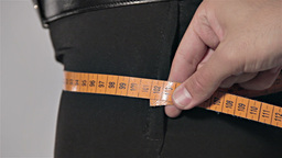 Tailor Measuring For Woman - Hips stock footage