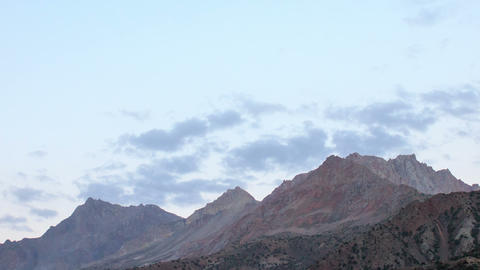 Clouds in light the setting sun. Time Lapse. Tajik Footage