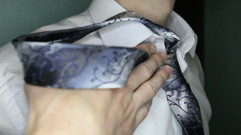 groom considers tie Footage
