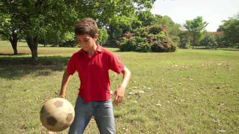 3of 18 Boy , Child , Kid Playing Soccer , Football stock footage