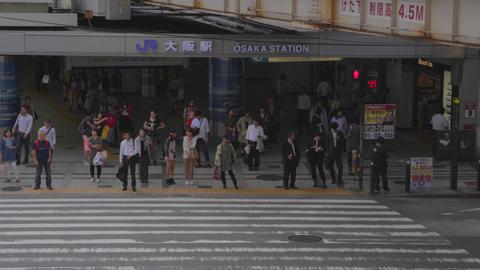aerial angle JR Osaka station - pedestrians wait Footage