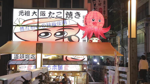 Cute Octopus Mascot Outside Restaurant - Dotonbori stock footage