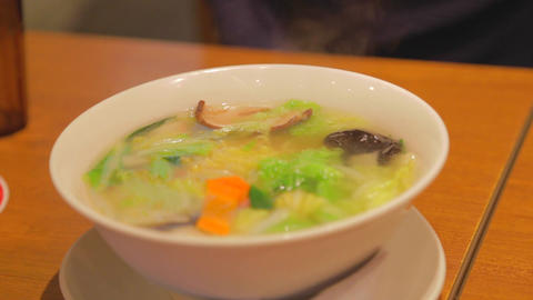 a hot bowl of vegetarian Japanese noodle soup Footage