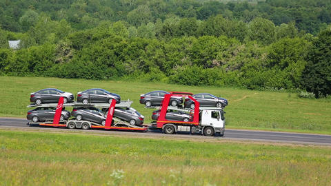 Truck Transports New Cars stock footage