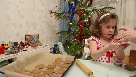 Little girl baking Christmas cookies Footage
