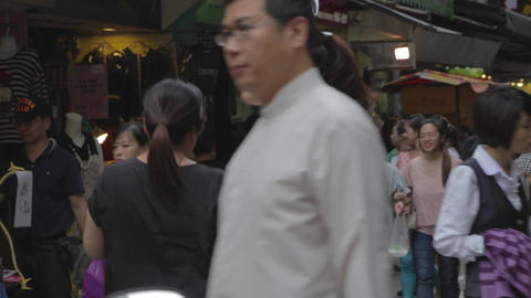 Business Lunch Crowd Walks Through A Market In Tai stock footage
