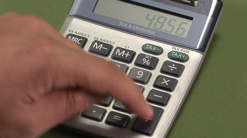 Man using calculator Footage