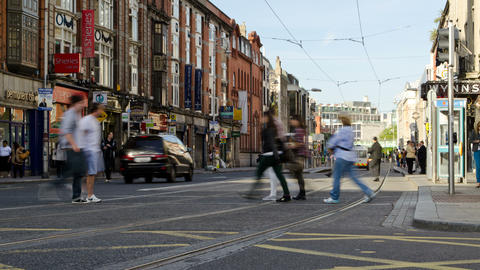 Time-Lapse People Crossing Across Busy Traffic and Tram In Downtown Footage