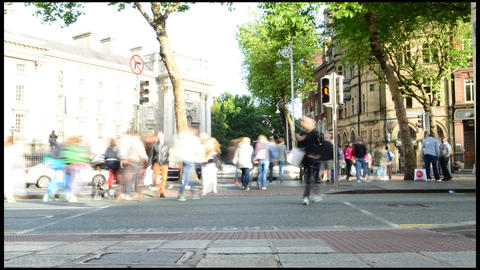 Time-Lapse People Crossing Across Busy Traffic In Downtown Footage