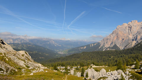 time lapse clouds contrails over dolomites 11552 Footage