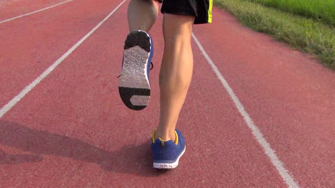Runner Running On The Track In Stadium stock footage