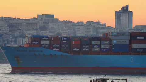 Large cargo ship sails past the city skyline Footage