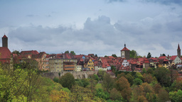Rothenburg on Tauber cityscape above the forest, c Footage