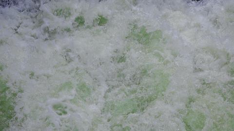 Sea foam in green waves Footage