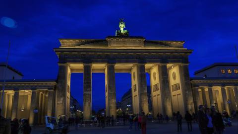 Brandenburg gates in Berlin with crowd and urban t Footage