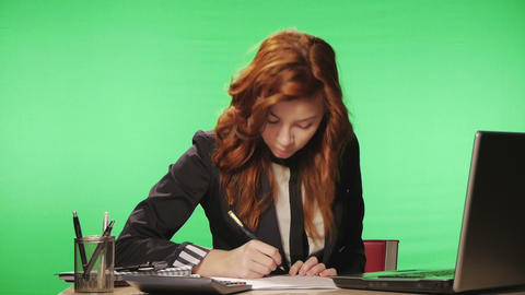 Business Woman working at the office (green screen Footage