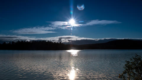 clouds and sun over the lake, timelapse Stock Video Footage