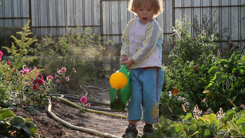 Boy and a watering can Footage
