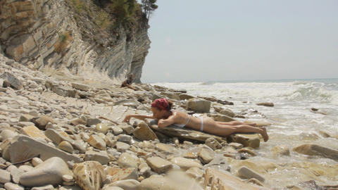 Girl lying on the beach Stock Video Footage