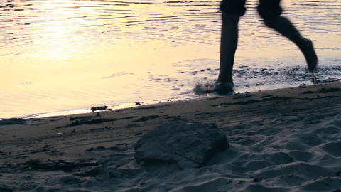 Woman feet running cross water Footage