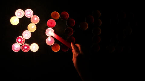 2012 made of colored candles on a black background Stock Video Footage
