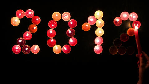 2012 made ​​of colored candles on a black background Stock Video Footage