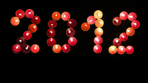 2012 made ​​of colored candles on a black background Footage