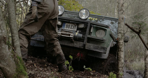 Pulling off a 4x4 offroad vehicle stuck on the tre Footage