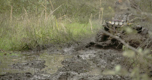 A 4x4 offroad vehicle splunging on the mud FS700 4 Live Action
