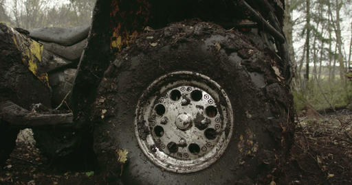 The muddy left wheel of the offroad vehicle FS700  Footage