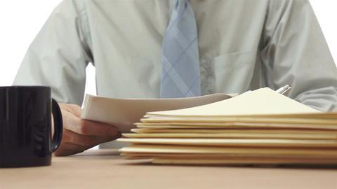 Male Office Files Onto Desk Footage