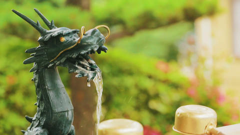 Dragon fountain spout used for hand cleansing at a Live Action